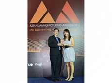Ms Chris Tan, Regional Operations Manager, Urschel Asia Pacific Pte. Ltd. accepting the award at the Asian Manufacturing Awards (AMA) gala dinner