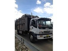 WJ Waste Bale Truck collecting bales of cardboard